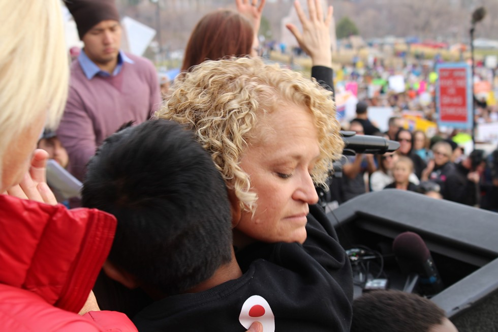 Mayor Jackie Biskupski embraces one of her children after delivering her speech. - ENRIQUE LIMÓN