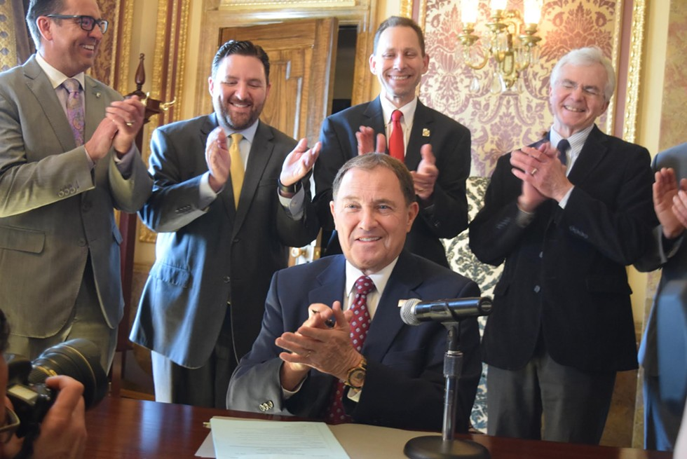 Governor Gary Herbert signs House Bill 472 on Tuesday, March 27. - RAY HOWZE