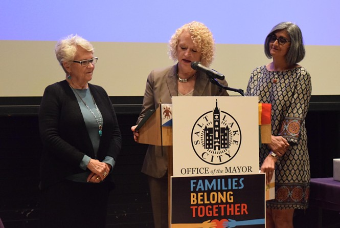 Rep. Carol Spackman Moss, left, Mayor Jackie Biskupski, middle, and Asha Parekh, director of refugee services at the Utah Department of Workforce Services, recognize refugees in Salt Lake City as part of World Refugee Day. - RAY HOWZE