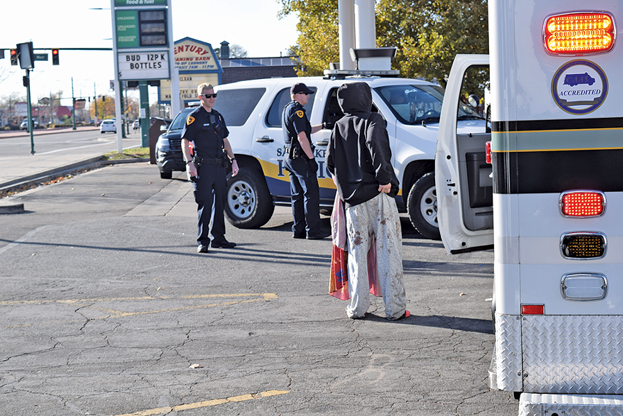 Police respond to a call regarding a homeless woman in the parking lot at 900 West and North Temple, a hotspot for illicit activity - since Operation Rio Grande started more than a year ago. - RAY HOWZE