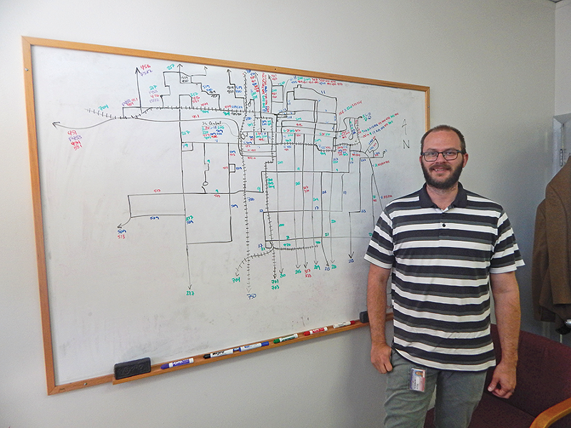 Eric Callison, UTA's manager of service planning, maps out Salt Lake City's transit system. - PETER HOLSLIN