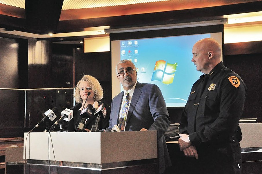 Salt Lake County District Attorney Sim Gill, flanked by Mayor Jackie Biskupsi and Police Chief Mike Brown, said Officer Matthew Taylor was justified in the 2015 shooting death of James Barker. - COLBY FRAZIER