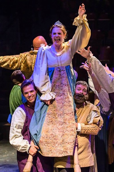 Princess Winnifred (Kat Tietjen) lifted by a knight (Randal McGuire) and the Wizard (Josh Astle) in Once Upon a Mattress. - DAVID SULLIVAN