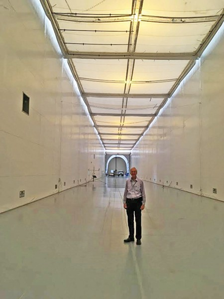 Engineer Branch Chief Gary Millar stands in the Joint Ambient Breeze Tunnel. - DW HARRIS