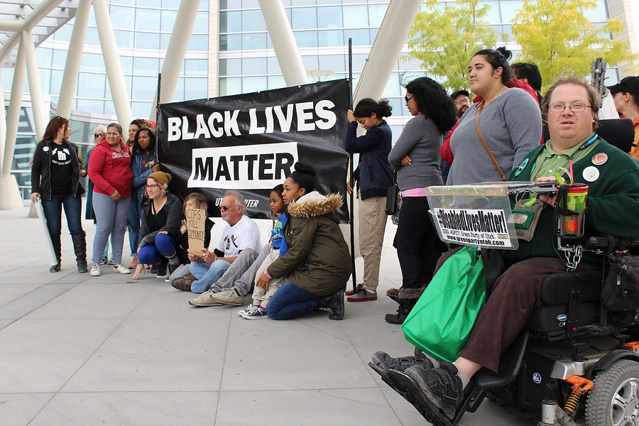 Black Lives Matter supporters rally outside the Public Safety Building on Saturday, Sept. 30 to demand Patrick Harmon body-cam footage be released. - ENRIQUE LIMÓN