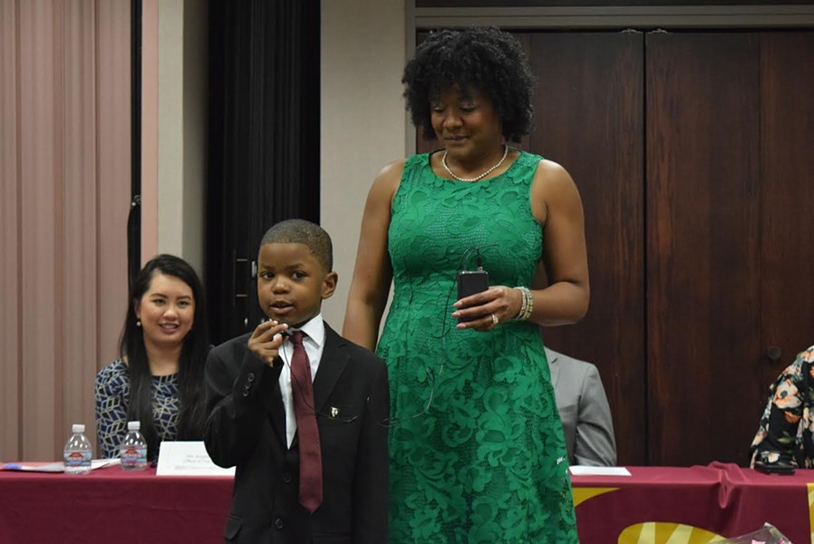 6-year-old Taj Thompson recites an excerpt from Martin Luther King Jr. following Friday's panel on racism. - RAY HOWZE