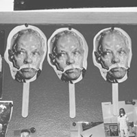 Photo Essay: Crude Awakening Photos of Hayes hang in Doug Wortham's classroom. These props were handed out to students during an assembly to honor Hayes.