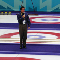 CEO of the Salt Lake Organizing Committee, Mitt Romney—in all his pleated-pants glory—says a few words before a curling event at the 2002 Games.