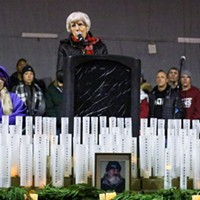 Pamela Atkinson, center, speaks during the annual Homeless Persons Memorial candlelight vigil.