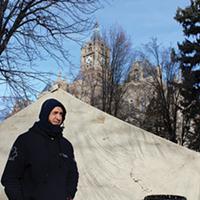 Take Shelter Coalition's Marvin Oliveros stands inside the makeshift Washington Square Park encampment midday on Friday.