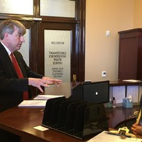 United Utah Party hopeful Jim Bennet, left, attempts to file at Director of Elections Mark Thomas' desk on Friday.