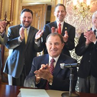Governor Gary Herbert signs House Bill 472 on Tuesday, March 27.