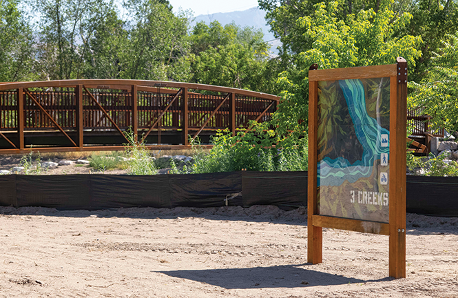 A new pedestrian bridge connects the Jordan River Parkway trail with Three Creeks Confluence, a new river park where the Red Butte, Emigration and Parleys creeks meet the Jordan River. - JORDAN ALLRED