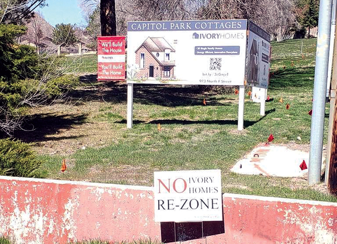 A coming attraction in the Avenues: Capitol Park Cottages (with a protest sign below) - KATHARINE BIELE
