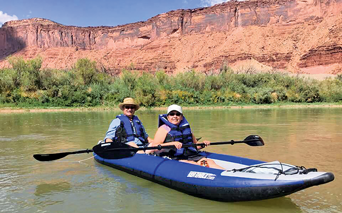 Author Rebecca Chavez-Houck and her husband floating the Colorado River - REBECCA CHAVEZ-HOUCK