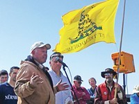 Phil Lyman listens to a speaker prior to embarking on an ATV protest ride in 2014 up Recapture Canyon. - ERIC TRENBEATH