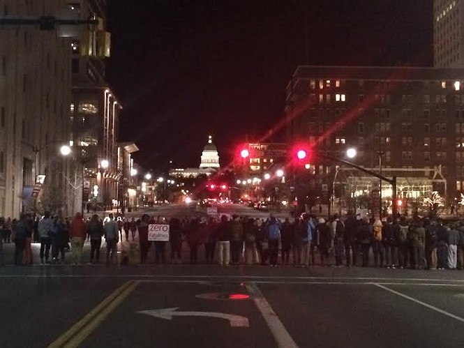Protesters block the intersection of 100 South and State Street during a February 2016 march against police brutality. - COLBY FRAZIER