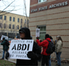 On Jan. 12, a small group of protesters gathered outside the State Archives Bldg. demanding oversight and justice.