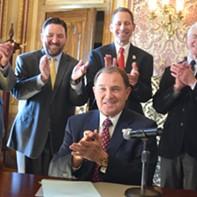 Guv Signs Medicaid Expansion Bill