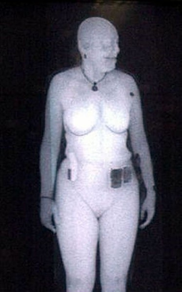 Woman being body scanned - TRANSPORTATION SECURITY ADMINISTRATION