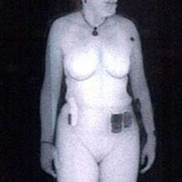 Woman being body scanned