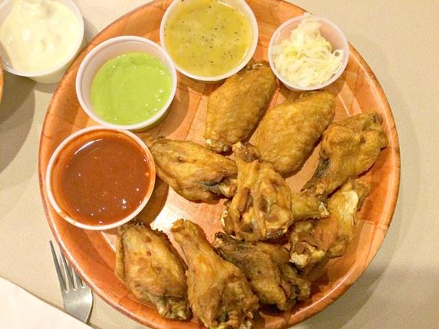 10 wings, $9.25 plus 50 cents per sauce