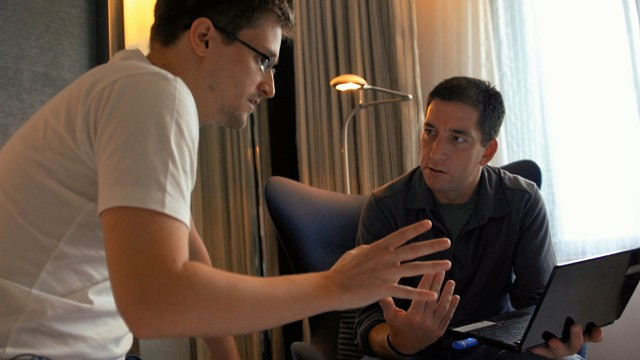 Edward Snowden (L) speaks with Glenn Greenwald in the film Citizenfour. - COURTESY MOUNTAINTOP FILM FESTIVAL