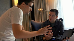 Edward Snowden (L) speaks with Glenn Greenwald in the film Citizenfour.