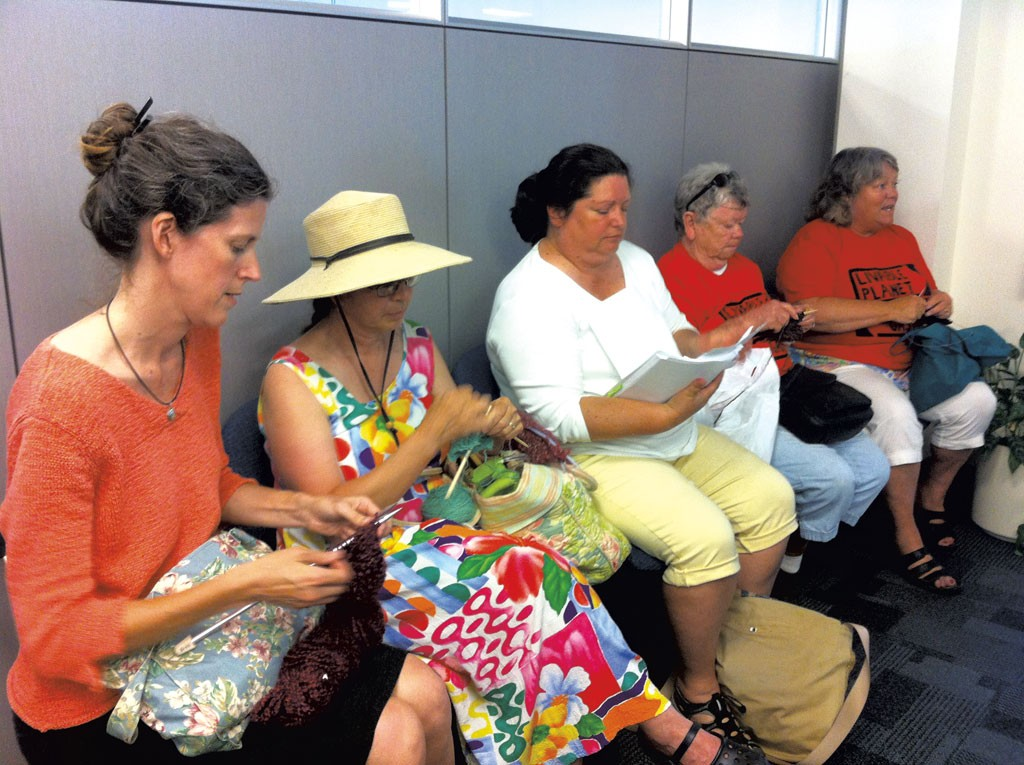 """A """"knit-in"""" at Vermont Gas headquarters in South Burlington - FILE: KATHRYN FLAGG"""
