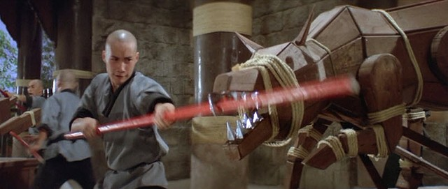 A monk fights a weird, silver-toothed wolf in Eight Diagram Pole Fighter - SHAW BROTHERS