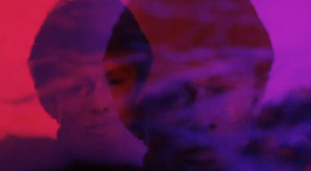 A purple, double-exposed George Chakiris in The Big Cube - WARNER BROS. PICTURES