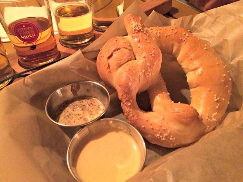 Pretzel with cider-cheese dip, $8 - ALICE LEVITT