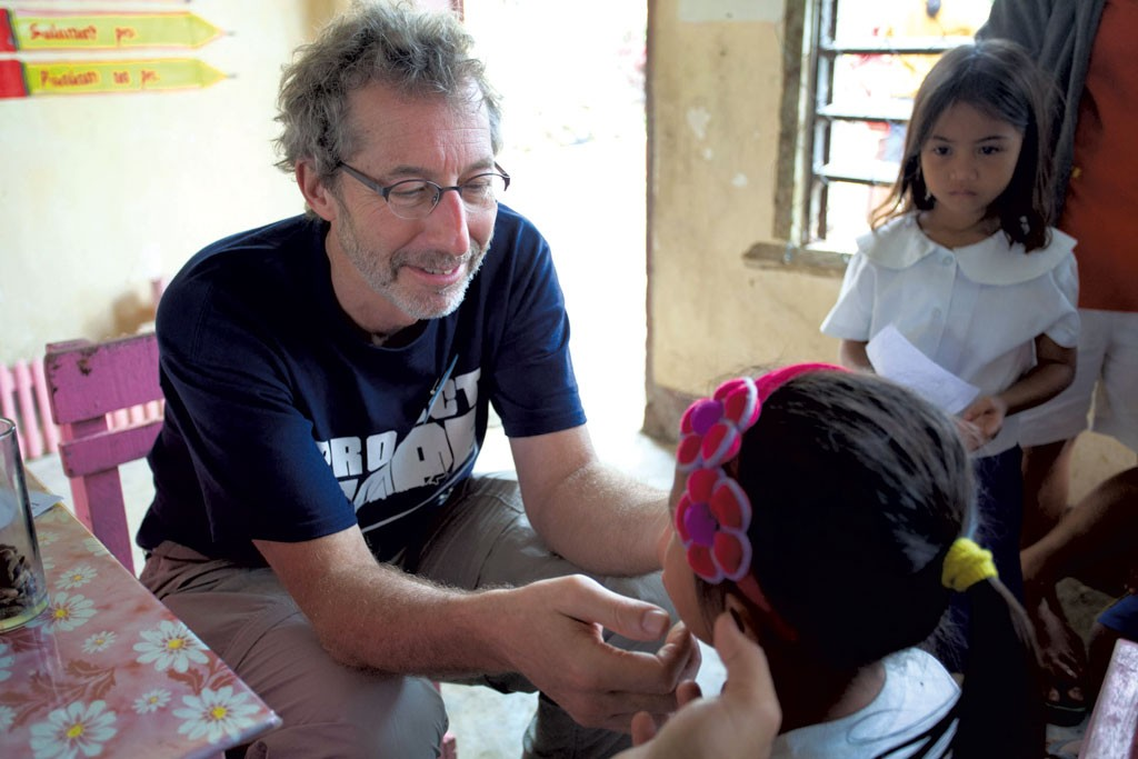 Barry Finette treating children in the Philippines - COURTESY OF BARRY FINETTE