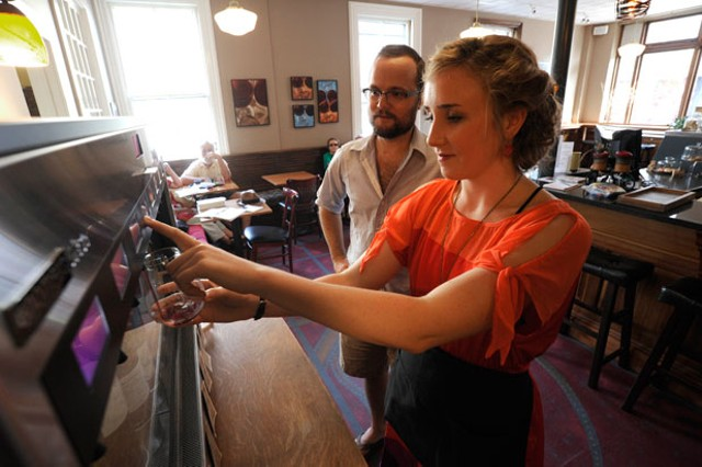Becky Parker pours a glass of wine from the Italian Enomatic wine dispenser at the North Branch Café - JEB WALLACE-BRODEUR
