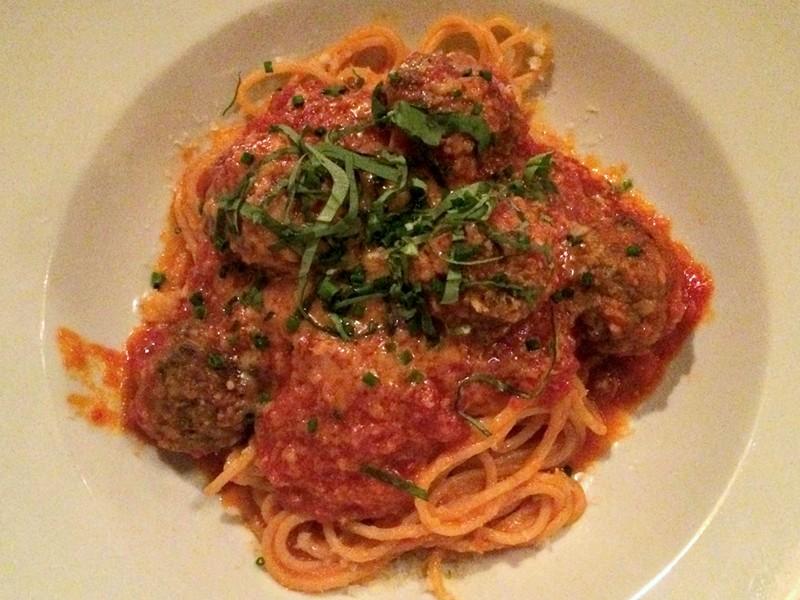 Beef meatballs over spaghetti - ALICE LEVITT