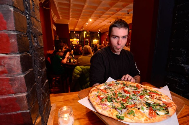 Blue Stone Pizza Shop and Tavern co-owner Chris Fish - JEB WALLACE-BRODEUR