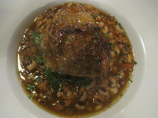 Braised chicken thigh over chorizo black-eyed peas