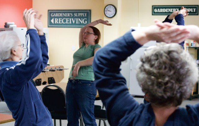 Bridget Kane leads the group in stretching - MATTHEW THORSEN