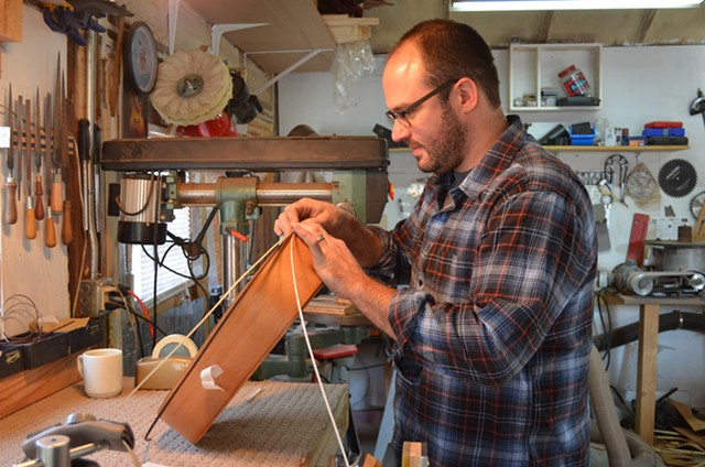 Buchwald works on a guitar in his garage. - ALICIA FREESE