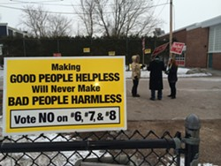 A sign urging voters to reject gun-control measures last year - MARK DAVIS