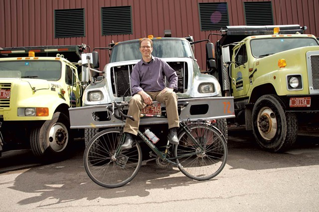 Department of Public Works director Chapin Spencer and a row of city trucks - FILE: MATTHEW THORSEN