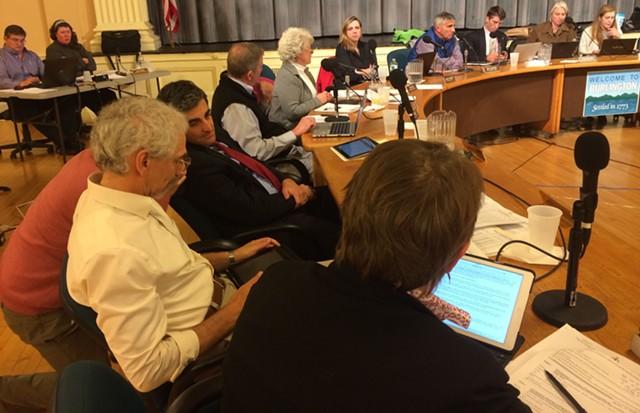 Burlington Mayor Miro Weinberger huddles with city employees during a city council meeting last night. - MARK DAVIS