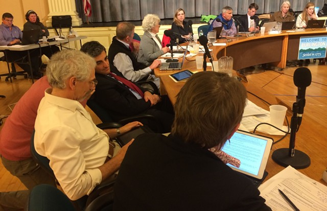 Burlington Mayor Miro Weinberger huddles with city employees during a city council meeting last night. - MARK DAVIS