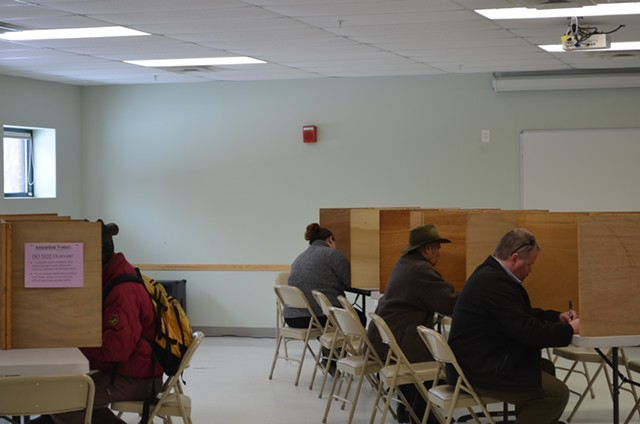 Burlington residents fill out their ballots on Town Meeting Day. - ALICIA FREESE
