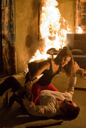 BURNING LOVE Morgan and Saldana hit (and kick and strangle) it off in White's offbeat new action comedy.