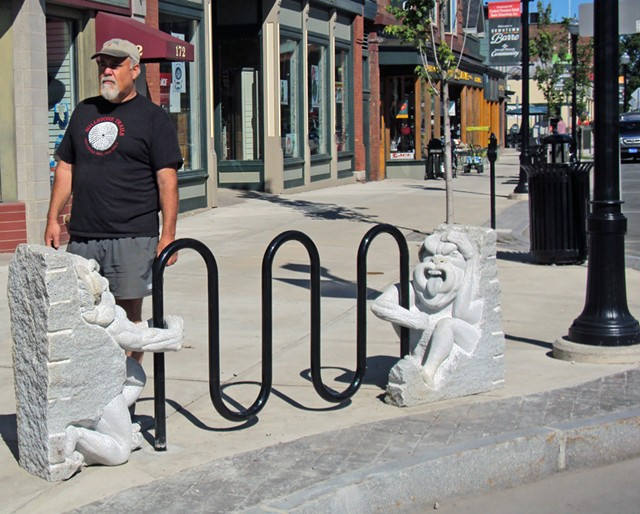 Calais sculptor Chris Miller on Main Street with the sculptural bike rack he created - COURTESY OF SUE HIGBY