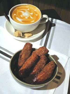 Cappuccino and churros - MATTHEW THORSEN