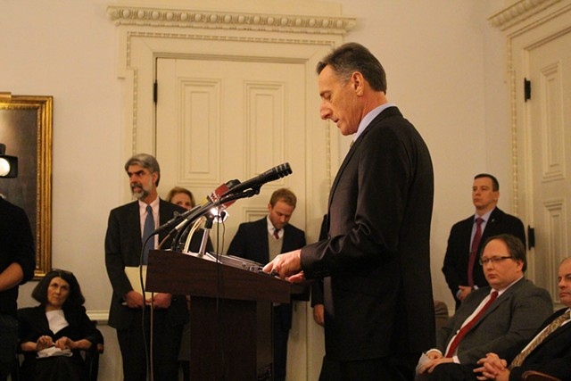 Caption: Gov. Peter Shumlin announcing the end of his drive toward single-payer last December. - PAUL HEINTZ