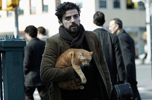 CAT TALE Isaac has an unlikely travel companion in the Coen brothers' comedy-drama about a struggling folk singer.