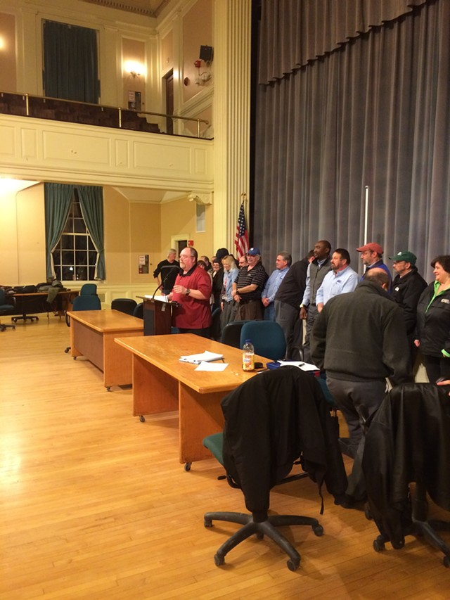 CCTA bus driver Mike Walker speaks to the crowd inside Burlington City Hall Auditorium on Thursday night. - MARK DAVIS